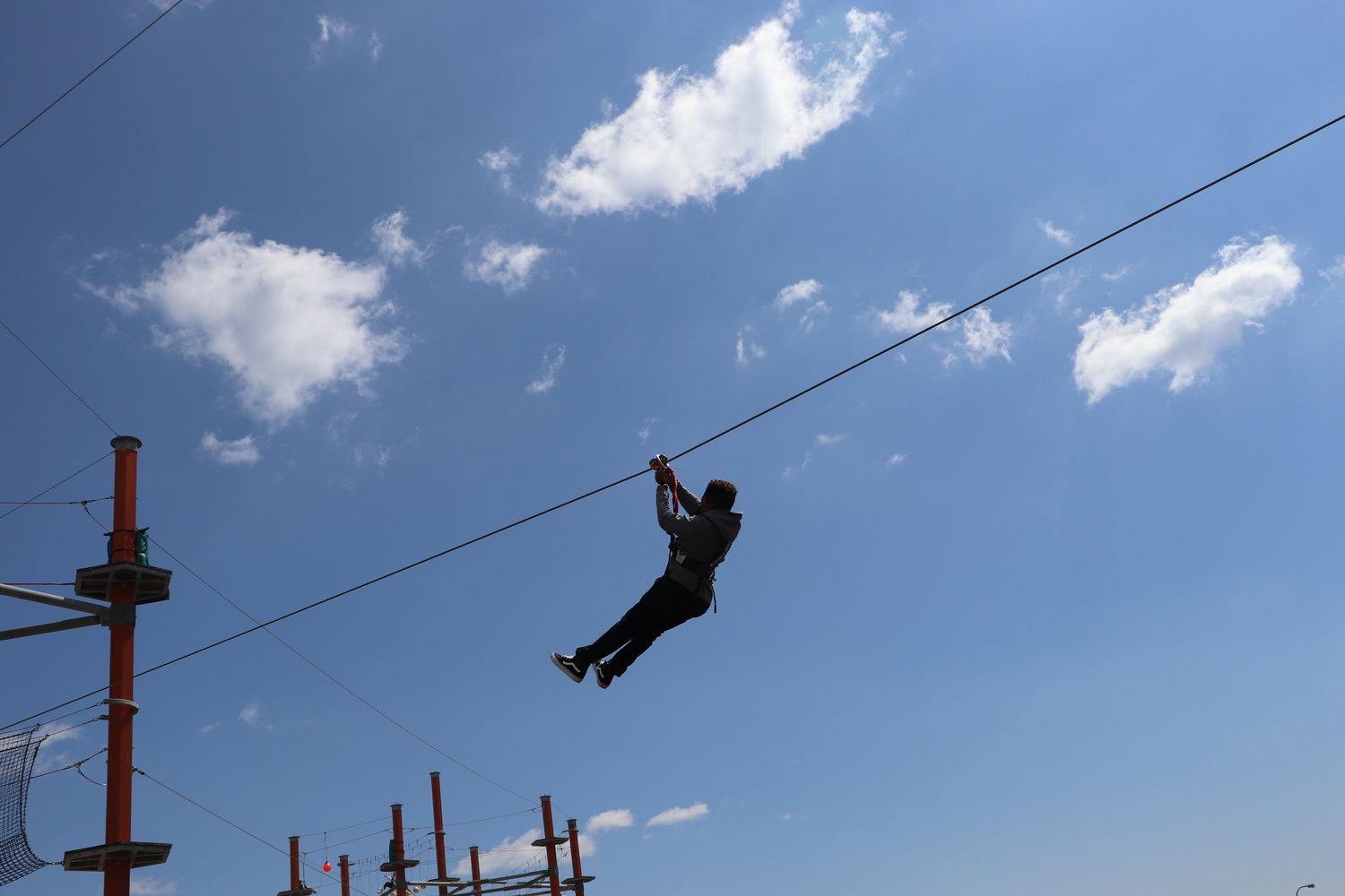 Taking a leap of faith on the 40-foot-high zip line course at WildPlay Element Parks Jones Beach.