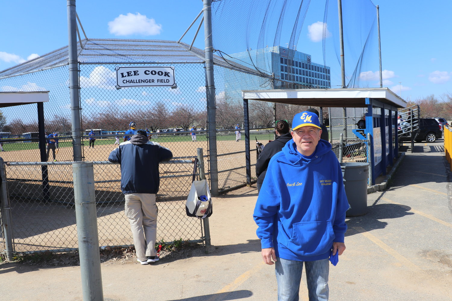 Lee Cook, founder and director of the Challenger League, right, at a field on Merrick Avenue that was named after him.