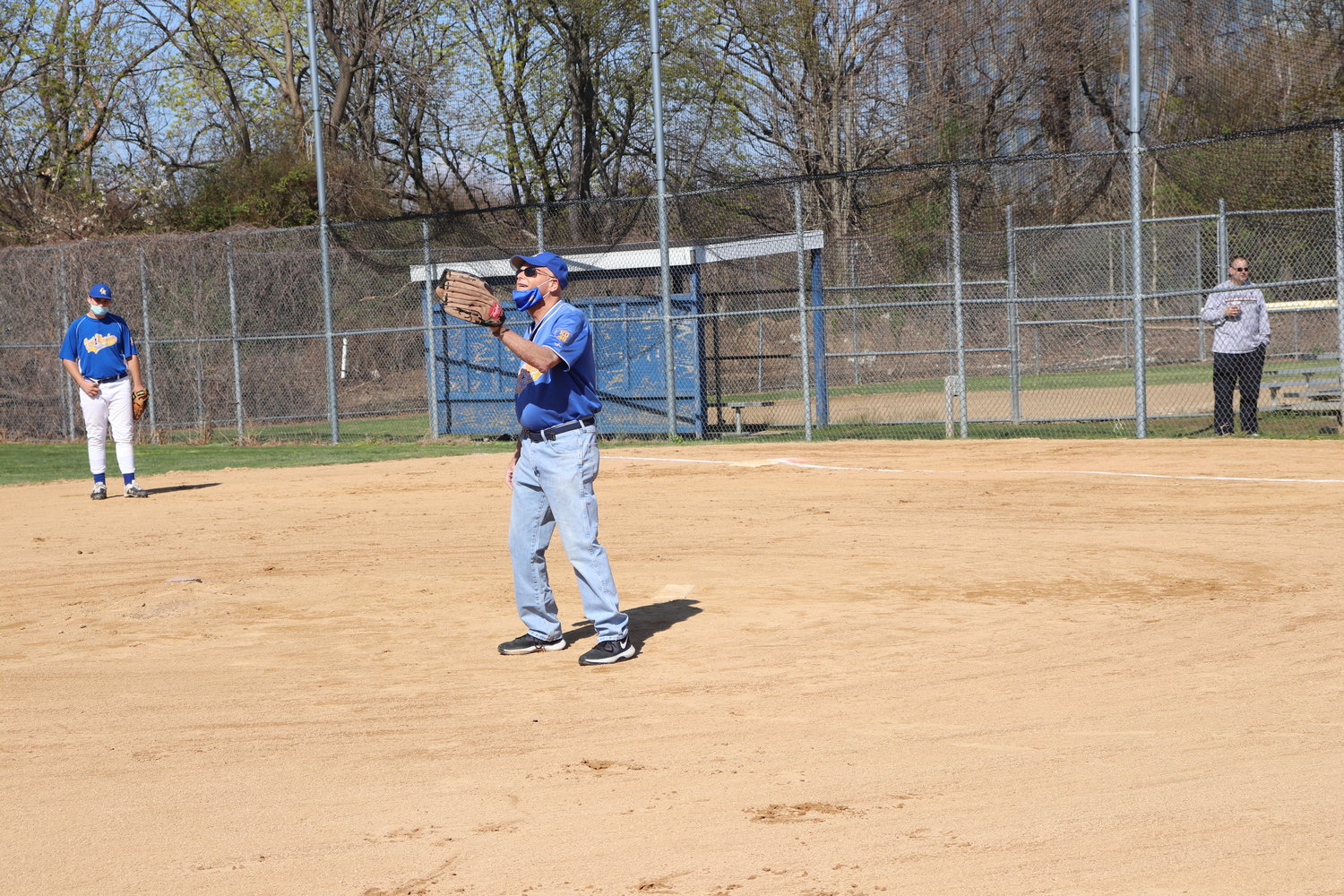 Coach Harvey Pollack, above, pitched on Sunday morning.