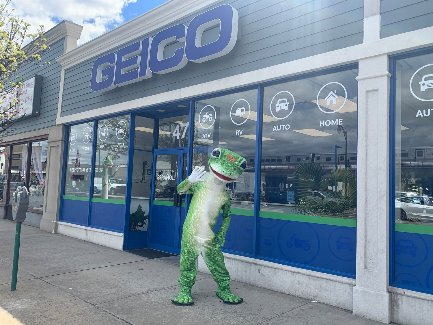 The Geico field office in Lynbrook opened on March 10 and offers a variety of services. The Geico gecko hangs outside the business one Saturday per month.