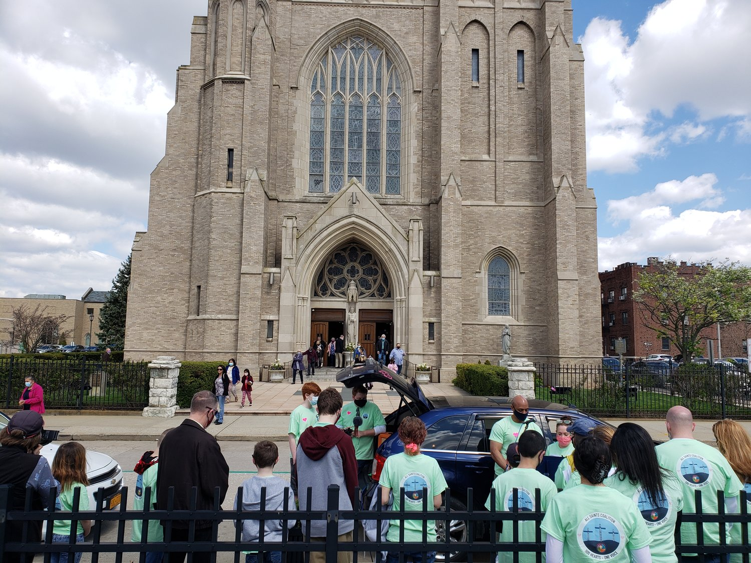 Dozens gathered outside St. Agnes Cathedral in Rockville Centre last Sunday to protest the closures of three Catholic schools.