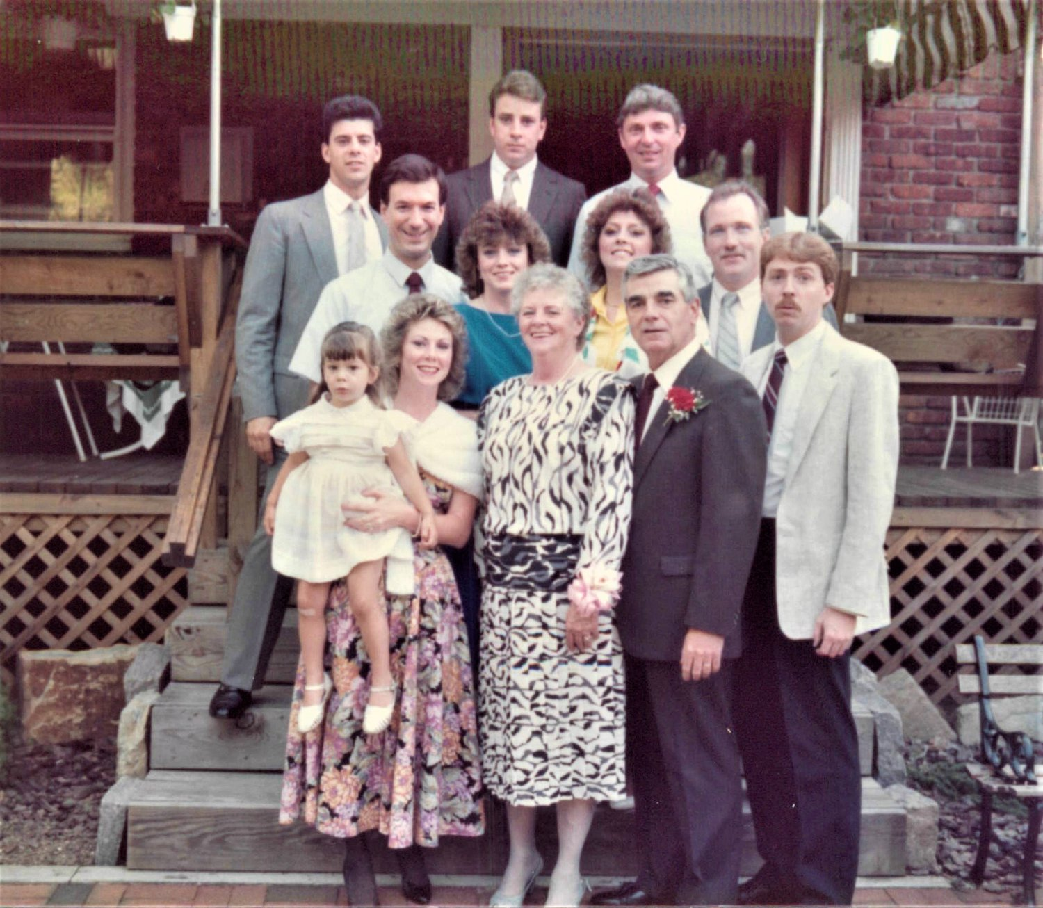 "The Stapleton family      gathered at Patrick Stapleton's retirement in 1988. In the first row, Deborah DeFino held her   daughter Kaitlin next to Mary ""Mickey"" Watts Stapleton, next to her husband, and son, both named Patrick."