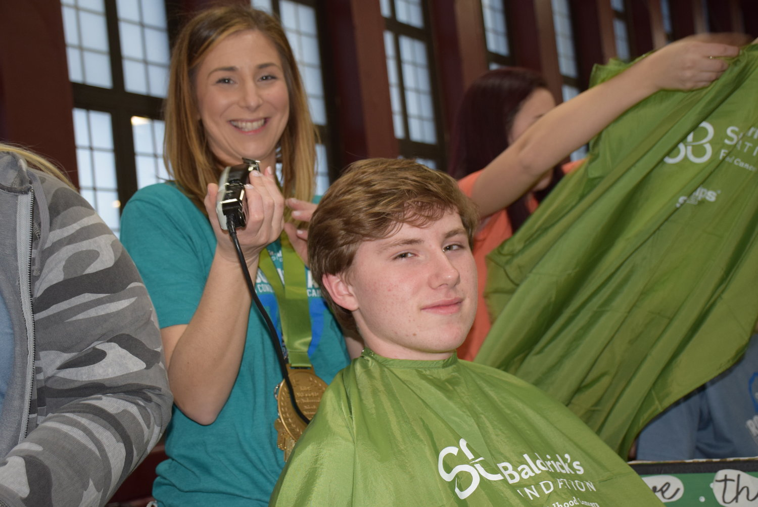 Mepham social studies teacher Jacqueline Geller was ready to shave student Pat Griffin's hair at the 2019 St. Baldrick's event.