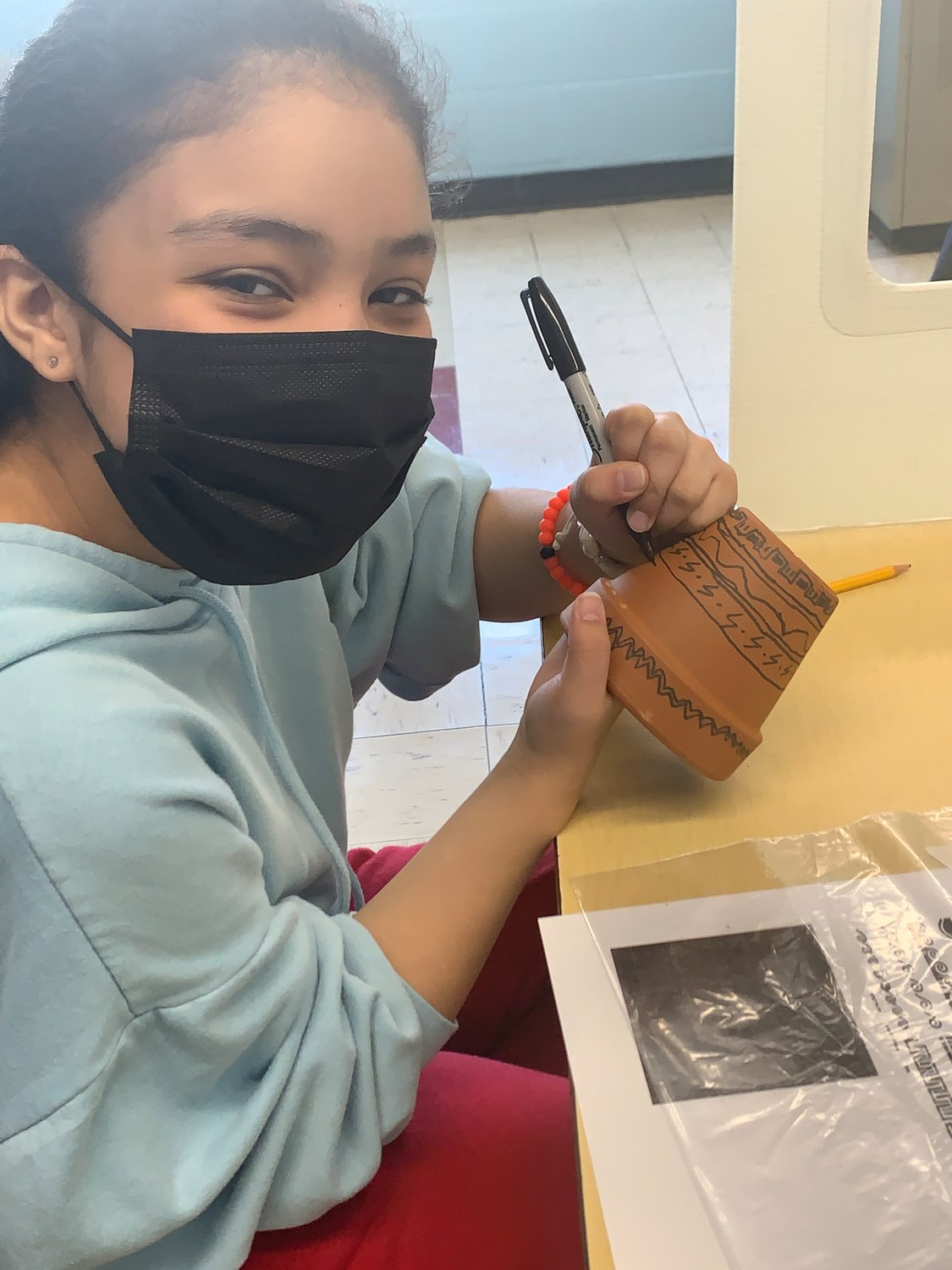Lawrence Elementary School sixth-grader Laura Archila Arroyo, worked on her clay pot
