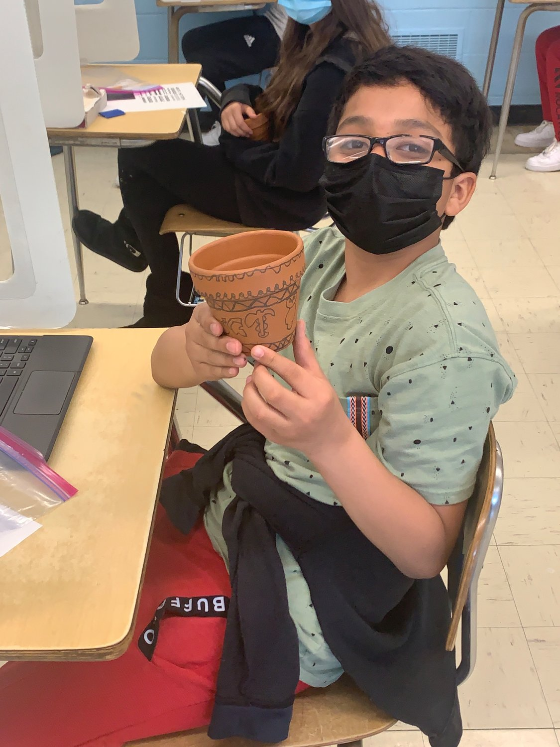 LES sixth-grader Edwin Gonzalez Murcia showed off his clay pot creation.