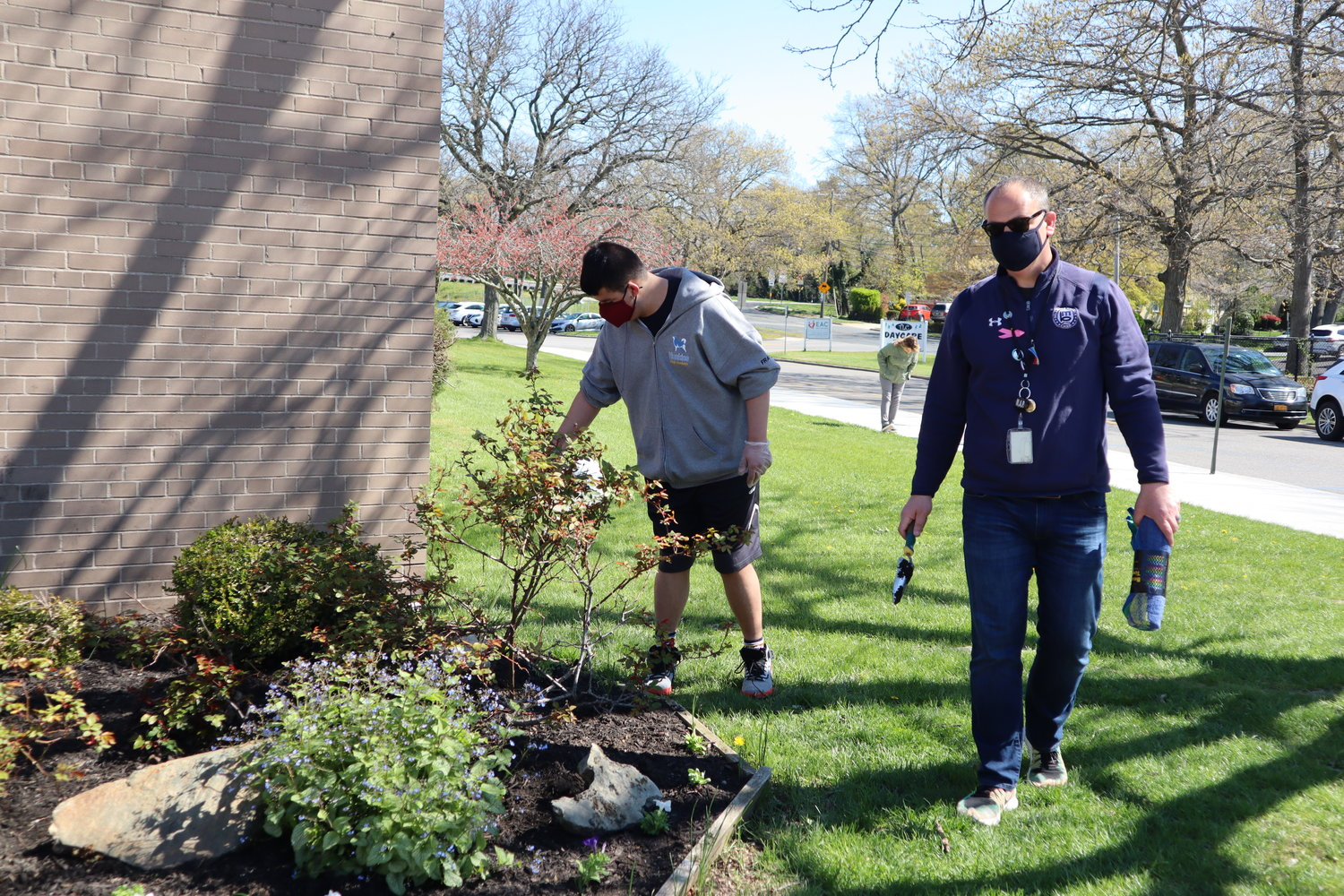 James watered the plants at the front of the school with Dr. Joseph Netto.