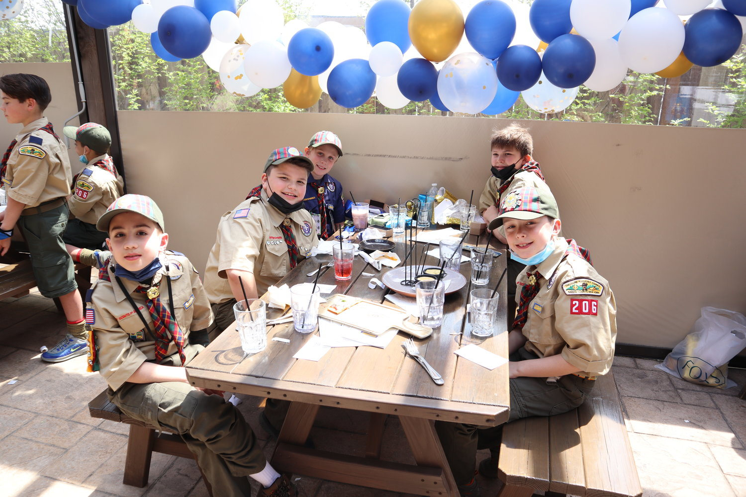 Cub Scouts in Troop 206 gathered at Garden Social in East Meadow to officially cross over into becoming a Boy Scout.