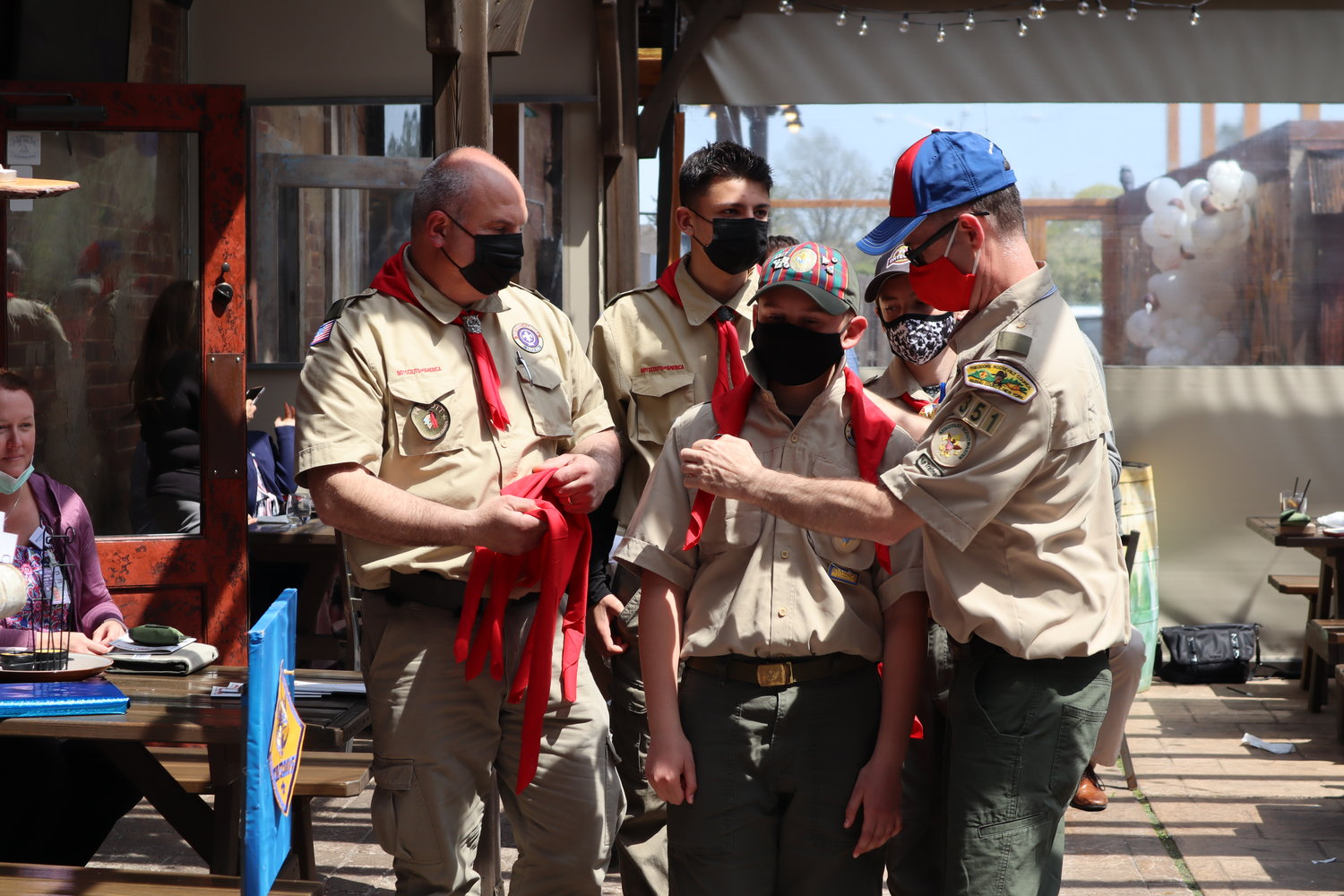 Troop 351 leaders provided a kerchief to Jason Bowman.