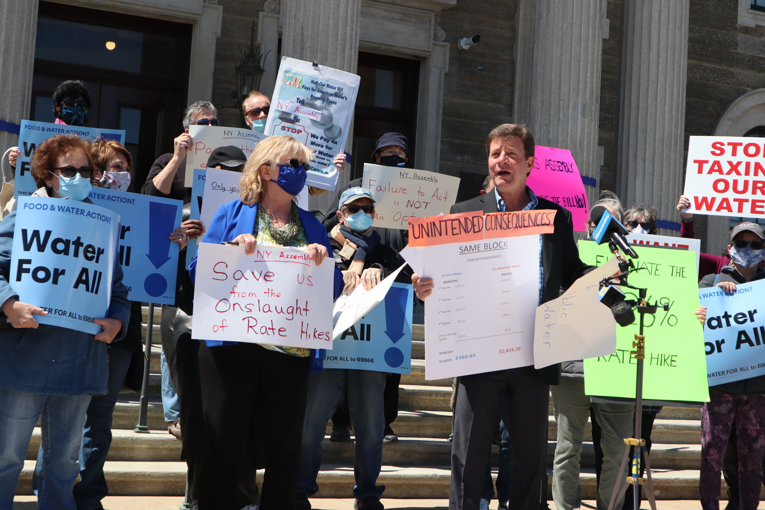 Claudia Borecky and David Denenberg, co-directors of the Merrick-based advocacy group Long Island Clean Air, Water and Soil, joined other advocates to call for companion 