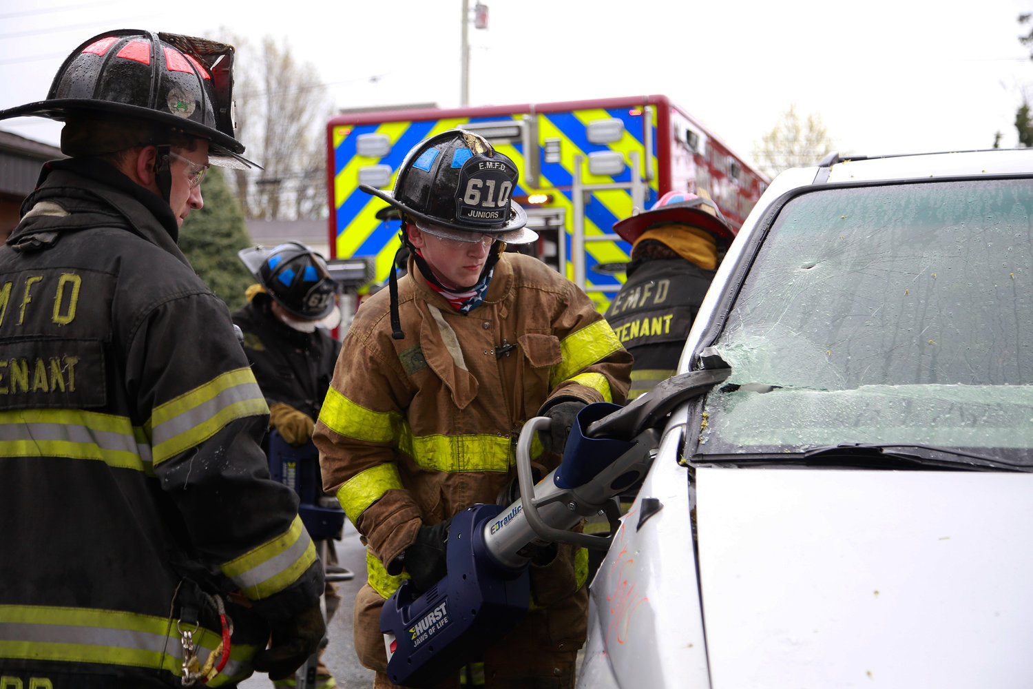 Danny Corr, a lieutenant at Ladder 1, left, supervised junior firefighter Aidan Finneran, 16, when he used the Jaws of Life on a vehicle during one of the demonstrations.