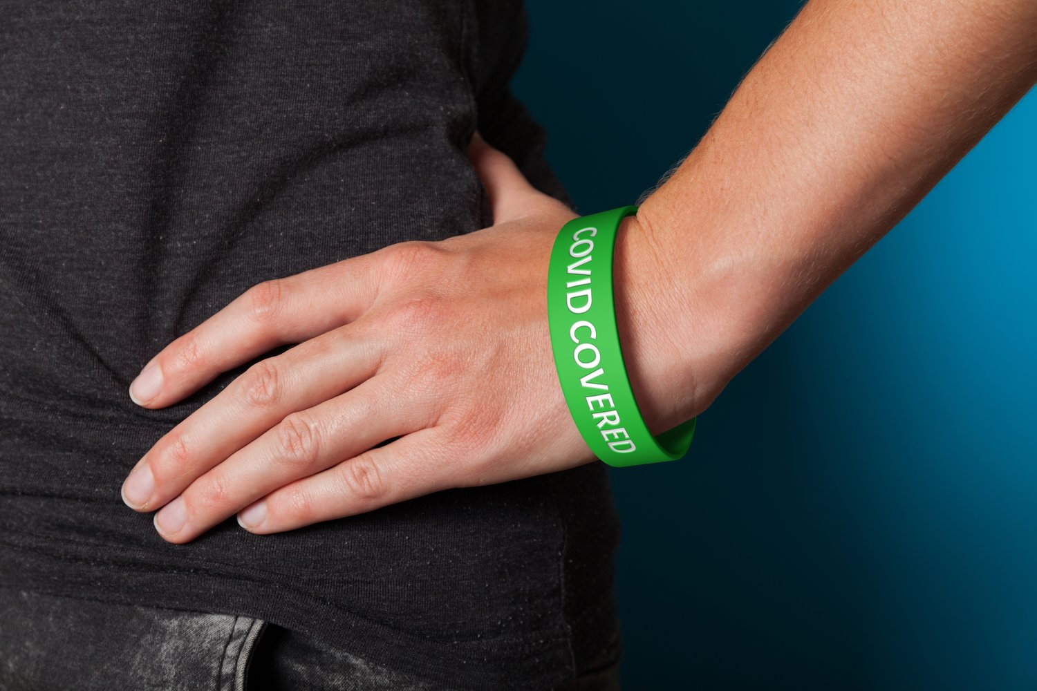 The Covid Covered wristband is green and bears those two words on both sides, signifying that its wearer has been vaccinated.