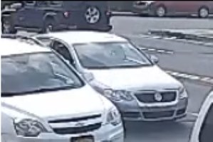 The Volkswagen Passat, center, that hit a 13-year-old boy in North Lawrence on May 2.