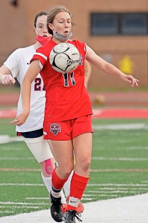 MacArthur's Fiona Killian, who scored in double OT to beat Garden City in the semifinals, settled the ball during the Generals' OT loss to South Side in the April 28 title game.