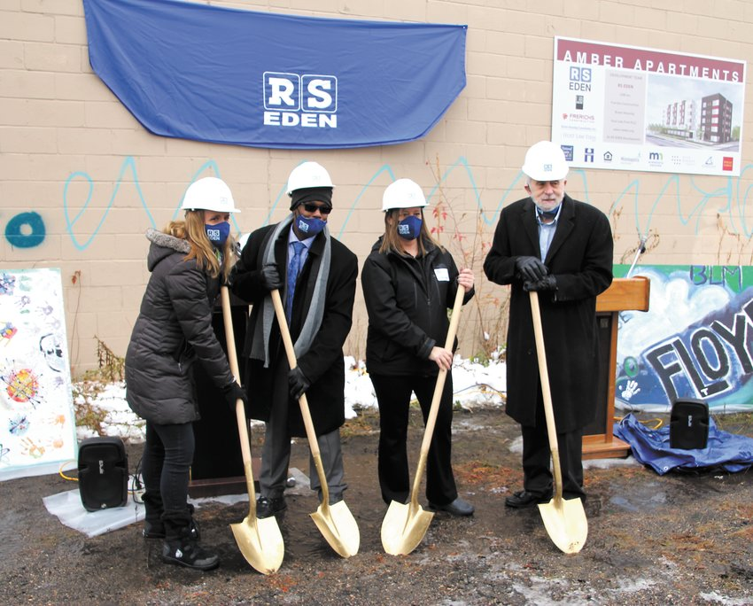 Folks break ground for the five-story, 52,178-square-foot Amber Apartments on Wednesday, Oct. 21, 2020. Left to right are RS Eden President and CEO Caroline Hood, former RS Eden client Cletus Robinson, building namesake Amber Cain, and former RS Eden President Dan Cain. The 80-unit building on the one-acre site just north of Walgreens along Hiawatha will replace the Bell Laboratory building. There will be a 25-space parking lot and inside storage for bicycles. One third of the property will be green space along what planner hope will soon be the Minn Hi Line linear park. (Photo by Tesha M. Christensen)