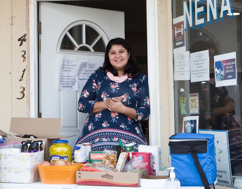 Karla Arredondo is NENA's Community Organizer and oversees the food distribution, which takes place on Tuesdays and Thursdays from 10 a.m. to 4 p.m. Call or text 612.293.9683 to schedule an appointment at least 24 hours before you plan to come; both English and Spanish are spoken. (Photo by Margie O'Loughlin)