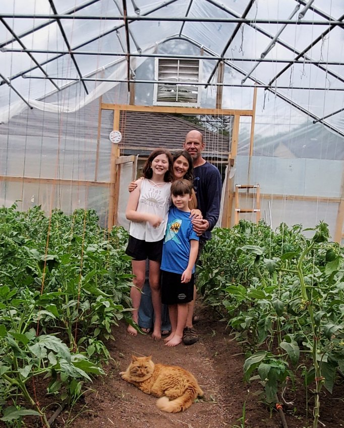 Gardening is a family passion for Longfellow residents David, Beth, Elsie (age 12) and Jack (age 9) Gray. Their latest project is a high-tunnel greenhouse and roadside stand south of Moon Palace Books. (Photo submitted)