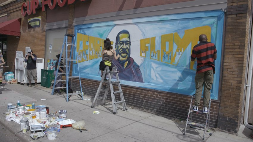 Cy Dodson's film includes footage of the mural being painted on the side of Cup Foods – the mural that is now recognizable across the globe. (Photo submitted)