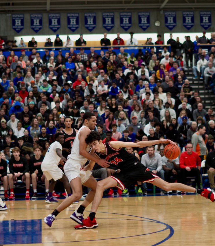 Minnehaha Academy boosted both Chet Holmgren (number 34) and Jalen Suggs (number 1) on last year's award-winning team. Holmgren was named Mr. Basketball after leading the Redhawks to the Class 2A state title on April 10, 2021. He is heading to Gonzaga next year. (Photos submitted)