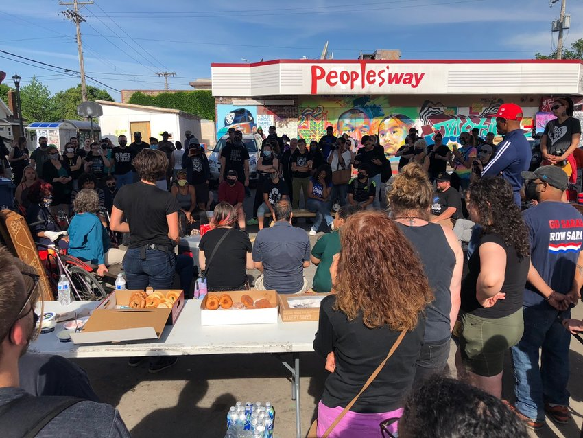 The morning meeting at George Floyd Square was packed  after the city pulled up its cement barriers during the early hours of June 3; within hours, makeshift barricades were placed by community members at each of the four entrances to the intersection.