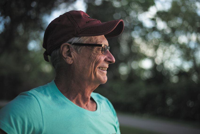 """Kevin Morgel rests on a bench along Lake Nokomis, observing the sunset. """"I have three goals: try to exercise everyday, to take at least one picture of the sunset, and to do a little writing. I am enjoying the evening,"""" he said.    >> Photo series   by Vanna Contreras"""