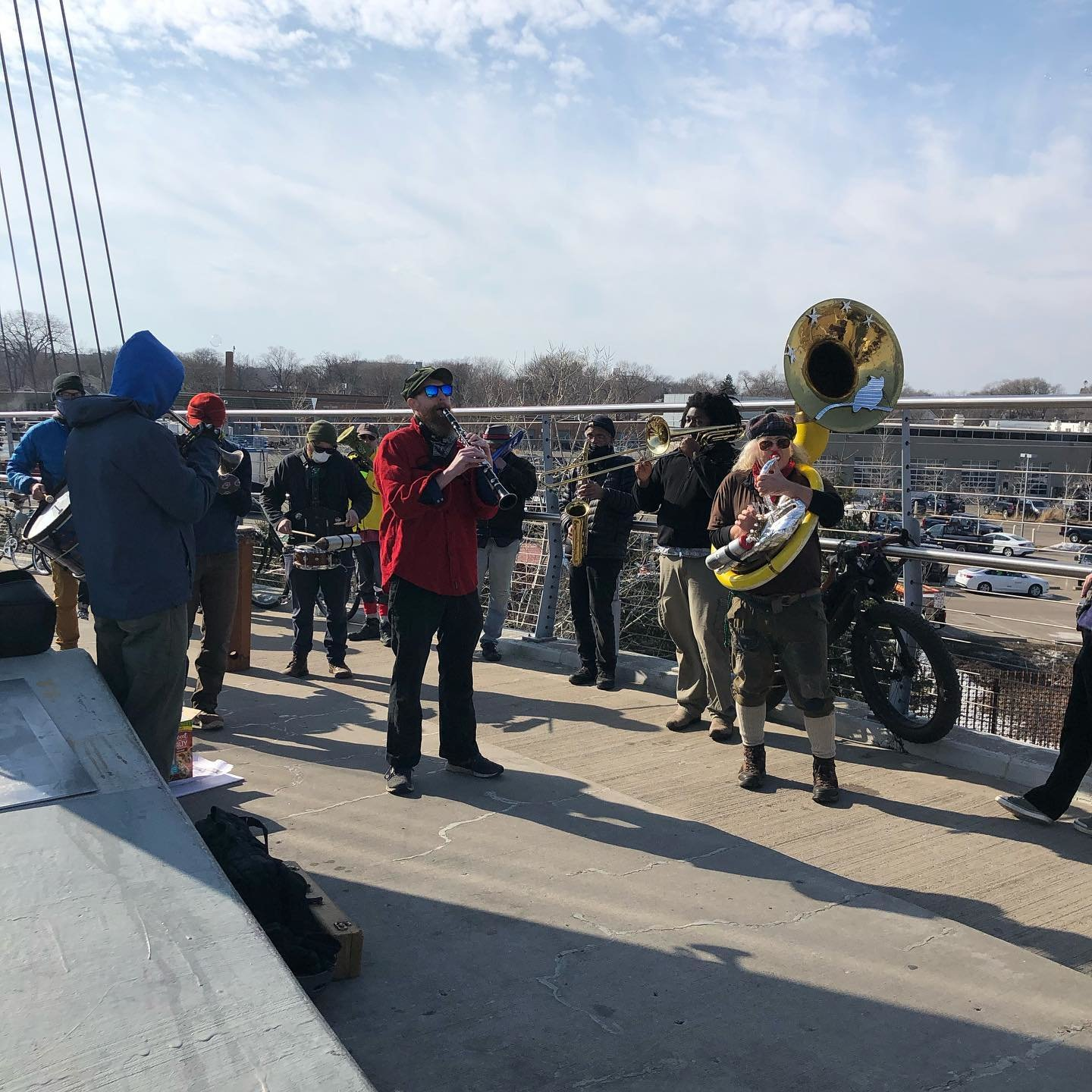 People rallied in support of the East Phillips Indoor Urban Farm on Sunday, March 7. They are standing on the Sabo Bridge overlooking the site.