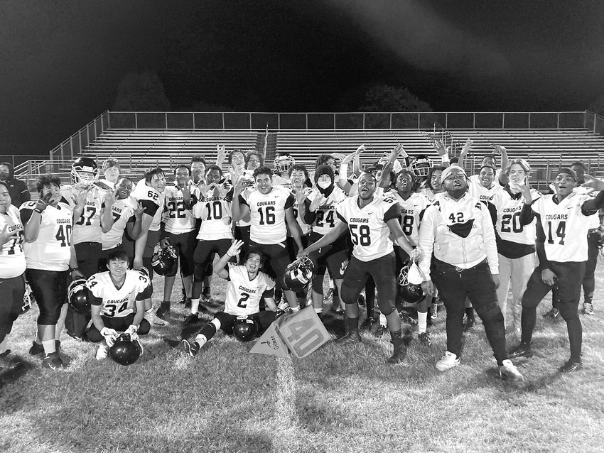 """The Como Park Cougars celebrated their season-opening """"W"""" against Highland Park. Como had a record of 3 wins and 0 losses as the Monitor went to press. (Photo submitted by Eric Erickson)"""