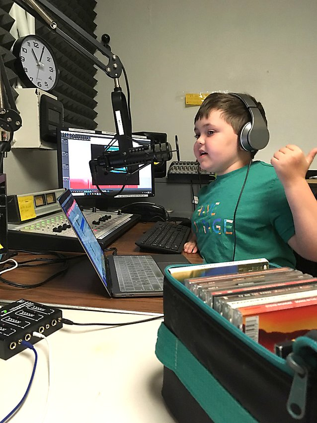 Murray Goff, who has cystic fibrosis, hosts a radio show with his sister, Olive, each Sunday morning on Frogtown WFNU 94.1. After interviewing real estate agent Kris Lindahl, they got a billboard to showcase their weekly episodes. (Photo submitted)