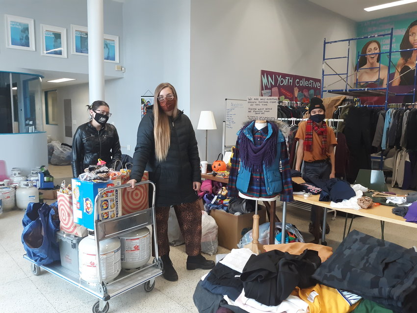Niqui, April and Sean of St. Paul Camp Support with just some of the supplies they bring to the encampments. The group collects supplies at 2161 University Ave. W., on Wednesdays and Fridays, 3-7 p.m. and Saturdays and Sundays 10 a.m.-2 p.m. They always looking for clothing, camp stoves, towels or tents. (Photo by Jan Willms)