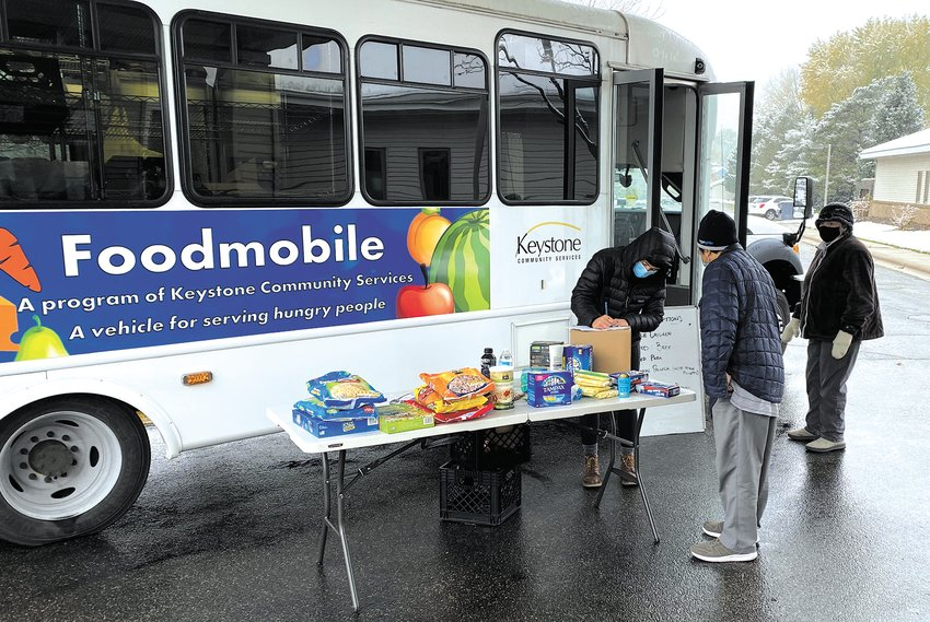 The two Foodmobiles make multiple stops in St. Paul each week, offering food choices. Find the schedule at keystoneservices.org. (Photo by Logan Murphy)