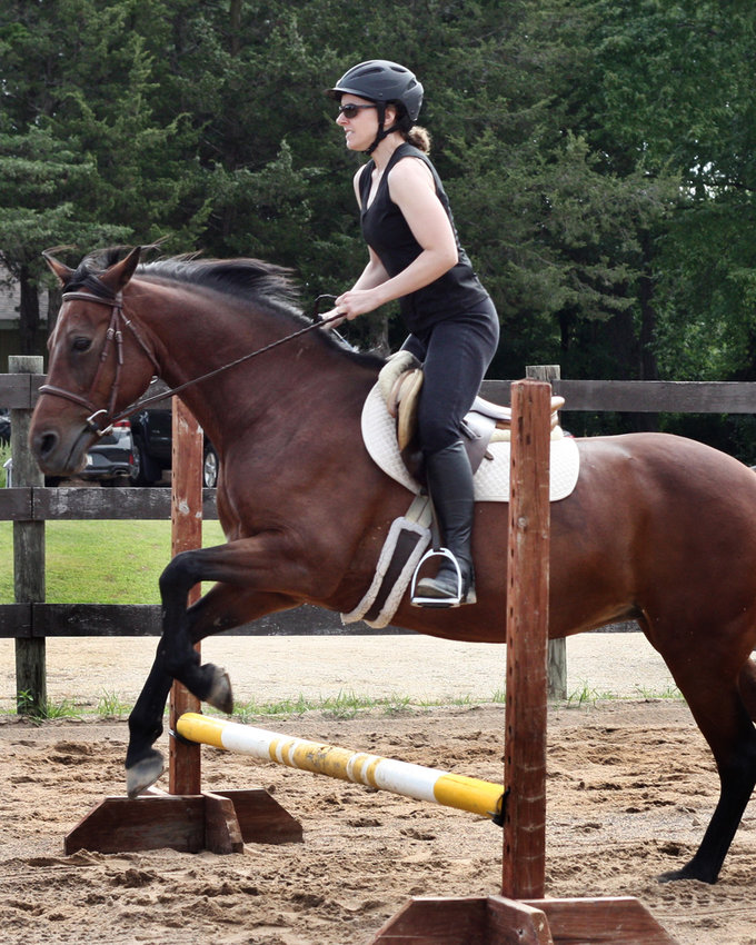 Lisa Whalen, author of the memoir Stable Weight: a Memoir of Hunger, Horses, and Hope, started jumping after she figured out how to ride on the flats. She remains a dedicated equestrian, and is a volunteer at the Animal Humane Society. (Photo submitted)