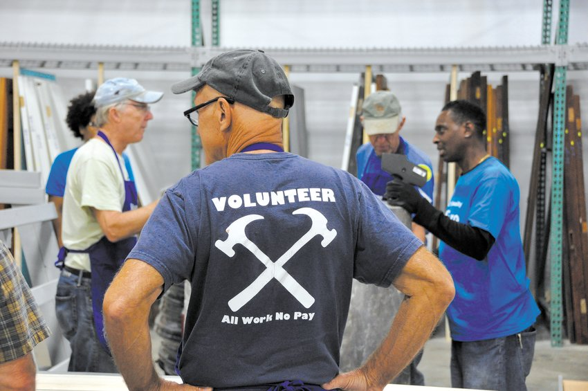 Volunteers assist staff at the ReStore locations. (Photo submitted)