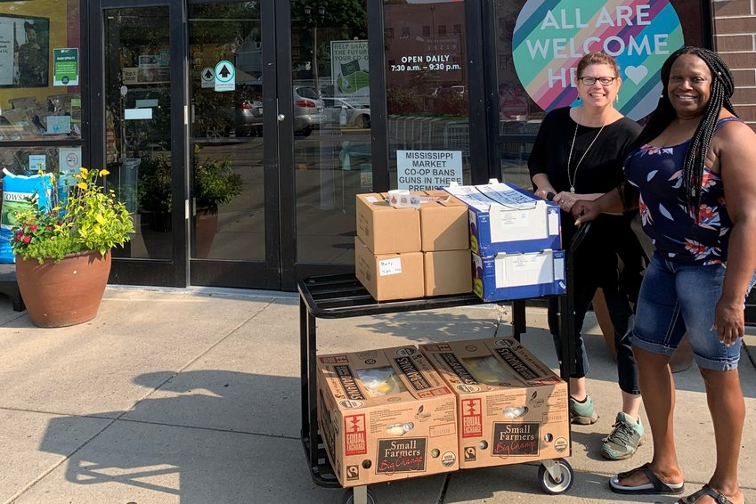 Mississippi Market staff with food donations. (Photo submitted)