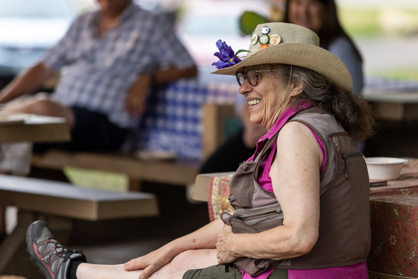 Diane Dodge was roasted and toasted by several dozen friends and admirers at a recent picnic at Newell Park. Best known for her relentless community activism and cheerful, flower-covered hats, Dodge is moving to rural Wisconsin to be closer to family. (Photo by John Pavlica)