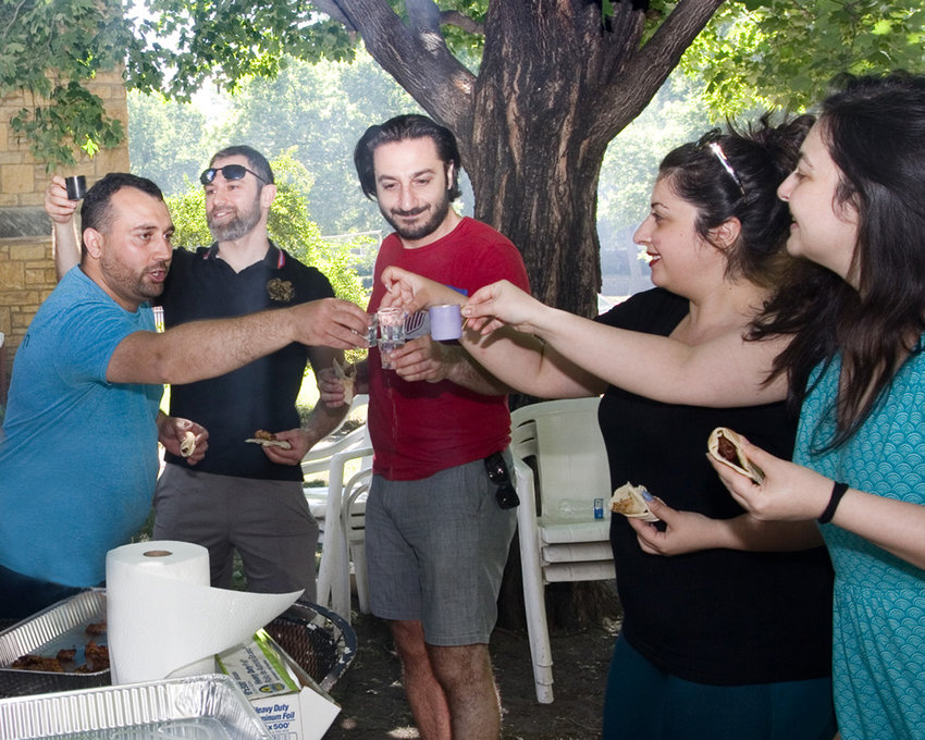 """Father Tadeos (far left) said, """"We have so much fun preparing for the kabob events and the festival. We don't want to focus only on the end result. It's important to enjoy the process."""" (Photo by Margie O'Loughlin)"""