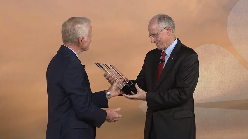 Former Congressman Mike Conaway, right, accepts the Farm Credit Bank of Texas (FCBT) Academy of Honor award from FCBT Board Chair Jimmy Dodson. The award recognizes Conaway's service to agriculture and establishes a $25,000 scholarship in his name.