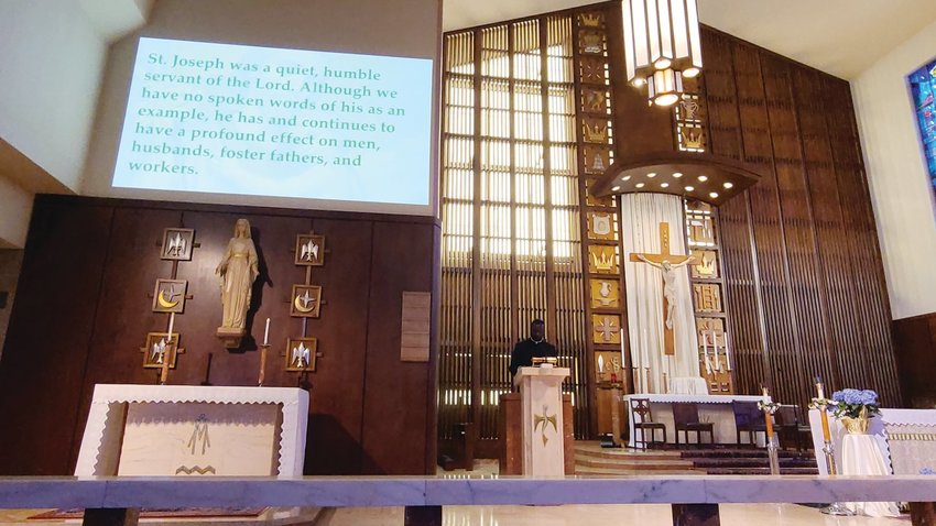 Father Joseph Brice, assistant pastor at St. Patrick Church in Providence, speaks on St. Joseph as a model for young men during a May 1 talk at St. Augustine Church in Providence. The talk was sponsored by the Men of St. Joseph and the Knights of Columbus of St. Augustine Church.
