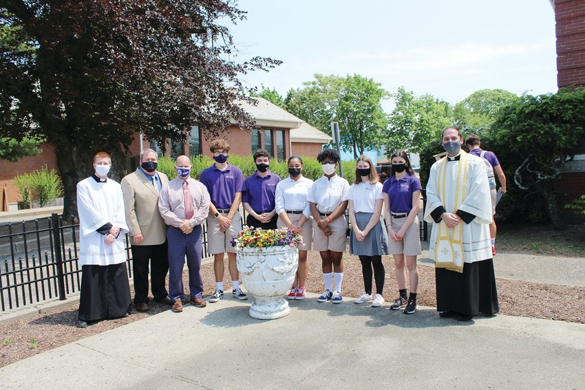 Pictured are seminarian Jay Zizzo, Steve Vargas, Vice Principal of Student Life Marc Thibault, students Josh Farrell, David Wilson, Natalya Cabral, Ralphletha Flowers, Clare Bradley, Isabel Sullivan and Academy Chaplain Father Ryan Simas.