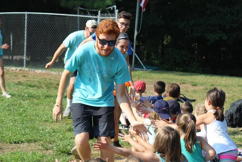 Camp counselor Nathan LaCroix enjoys his summer days at Mother of Hope Camp on Echo Lake. He said that the camp experience played an important role in his journey to becoming a Catholic.