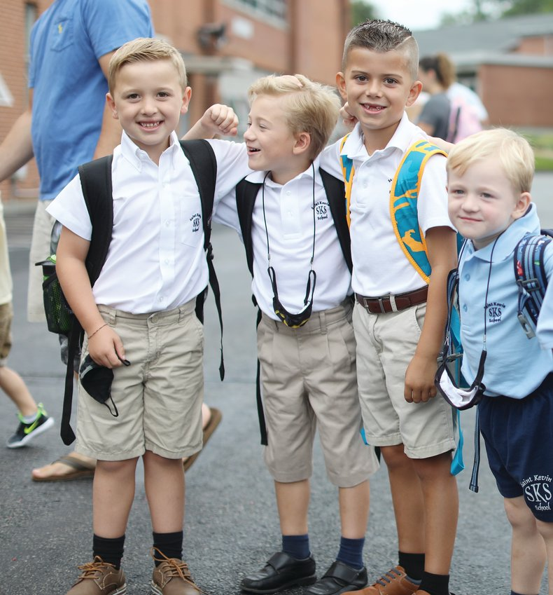Rhode Island Catholic school students celebrate their first day back to class. Despite a few raindrops, students from St. Kevin School in Warwick were all smiles for their first day, September 1.