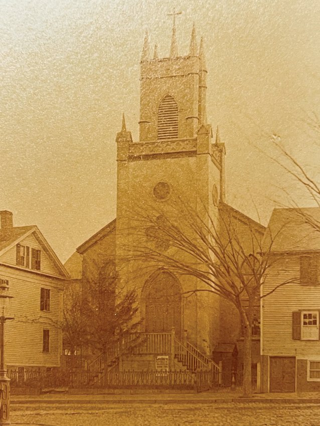 A rare view of the original Church of SS. Peter and Paul, one of the early stone churches built in Providence, where Mass was first celebrated on March 10, 1837. The cornerstone was laid on the site 41 years later, on Nov. 28, 1878, for the current Cathedral of SS. Peter and Paul.