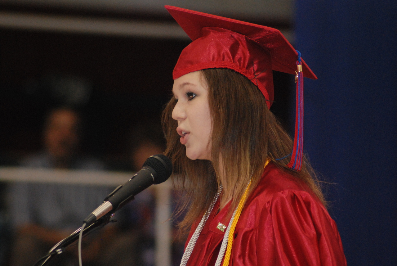 ACCOMPLISHMENTS:  Providence College-bound Mistress of Ceremonies Ashley Berube speaks to her classmates.