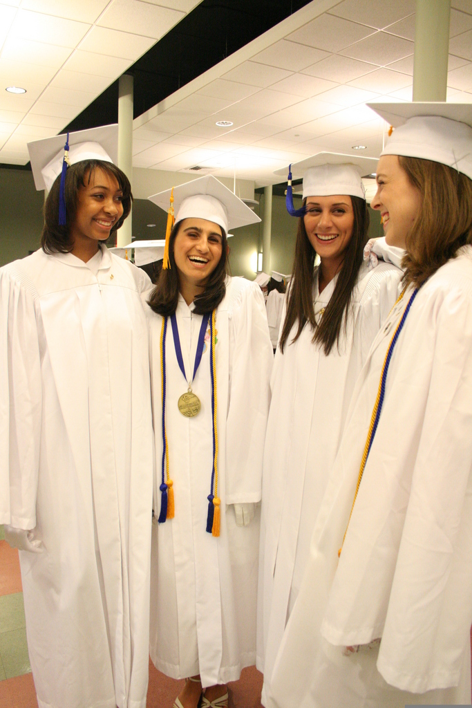 LASTING FRIENDSHIPS: From left to right, Alexus Lee, Gina Roberti, Molly Alves, and Kelsey Petrie smile minutes before they process into the the Cathedral of SS. Peter and Paul. The accomplished graduates of the St. Mary Academy–Bay View class of 2010 will attend many prestigious colleges and universities this fall.