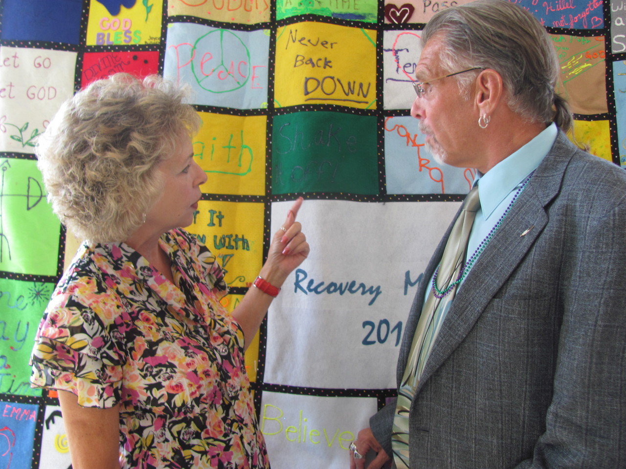 CELEBRATING RECOVERY:  Rep. Patricia Serpa, D-27, West Warwick discusses one of the colorful panels in the 2010 Recovery Quilt with Jim Gillen, clinical coordinator of Recovery Services at The Providence Center. Gillen will offer a clergy and pastoral training program on Sept. 23 at the Cathedral of SS. Peter and Paul.