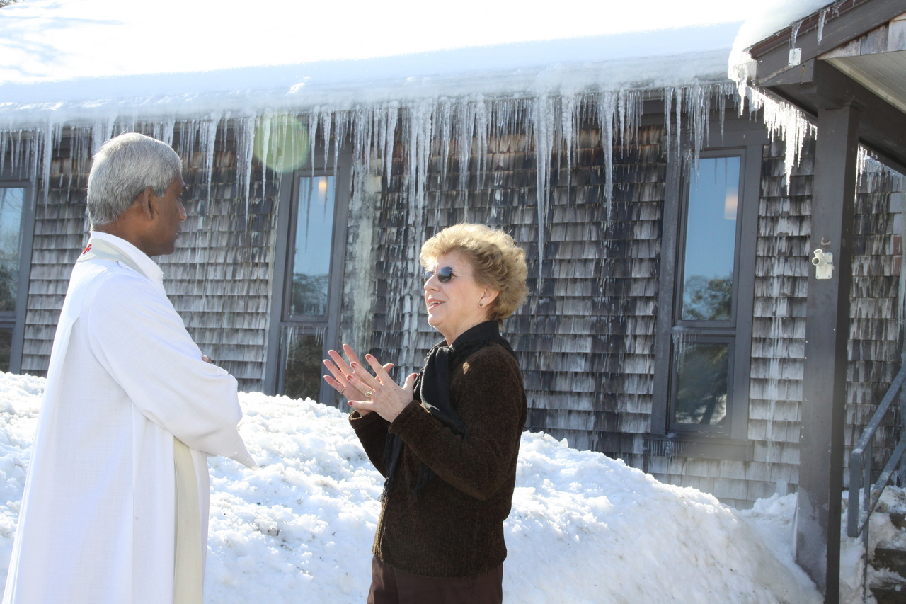 WINTER WONDERLAND: Father M.J. Bernard Dore, pastor of Saint Paul the Apostle Parish, Foster, listens as parishioner June Haapala marvels at the beauty created around the church by the recent heavy snowfalls.