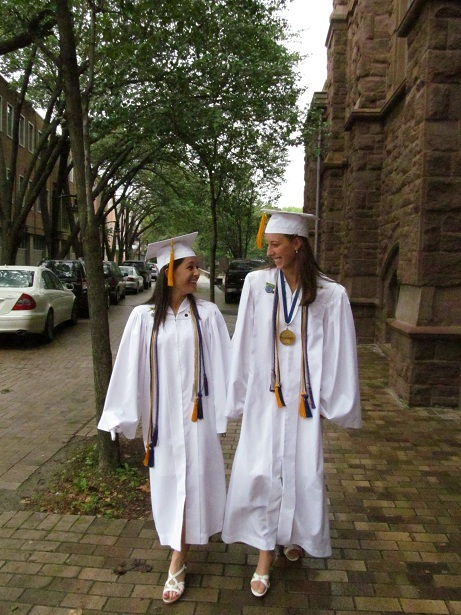 FORMING MINDS AND FRIENDSHIP: Friends Krista Sevigny, who will be attending Providence College in the fall, walks into the Cathedral of Saints Peter and Paul with Valedictorian Taylor Jackvony, who will attend Williams College and majoring in biology.