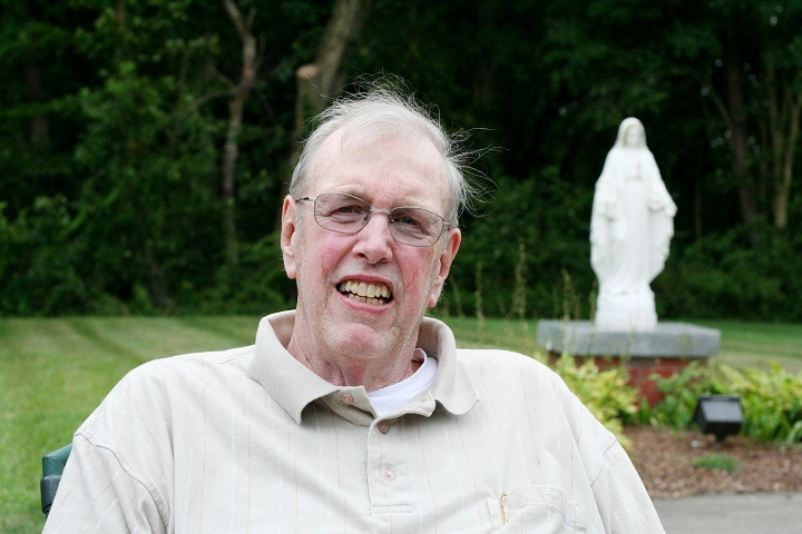 REST AND RELAXATION: Father Raymond Luft enjoys relaxing at his new home at the St. John Vianney Residence in Providence. Since 1985, he has served as chaplain to the Providence Police Dept., an important role he will continue to perform.