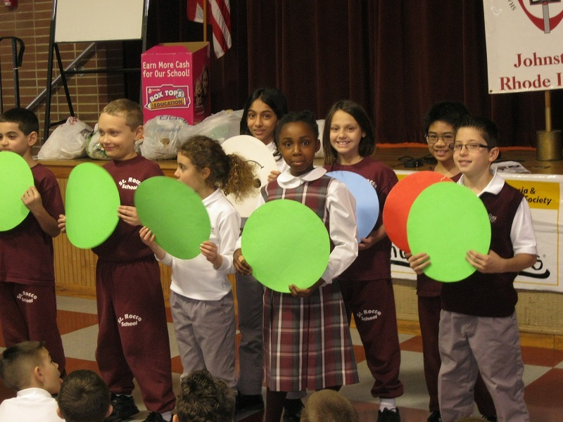 Students from St. Rocco School in Johnston hold up different color circles representing both good and bad blood cells during an assembly to kick-off the Pennies for Patients campaign. Students will bring in their loose change for the next three weeks to benefit the program that informs elementary and secondary school students about the diseases leukemia and lymphoma.?Their donations will help to support research and patient services of the Leukemia & Lymphoma Society. Last year, St. Rocco School raised more than $4,000. During this Year of Faith, Catholics are called to focus on charity, as it is the responsibility of the church to help one's neighbors. As a community, Catholics are called only called to practice love, but to also be of service to our brothers and sisters.