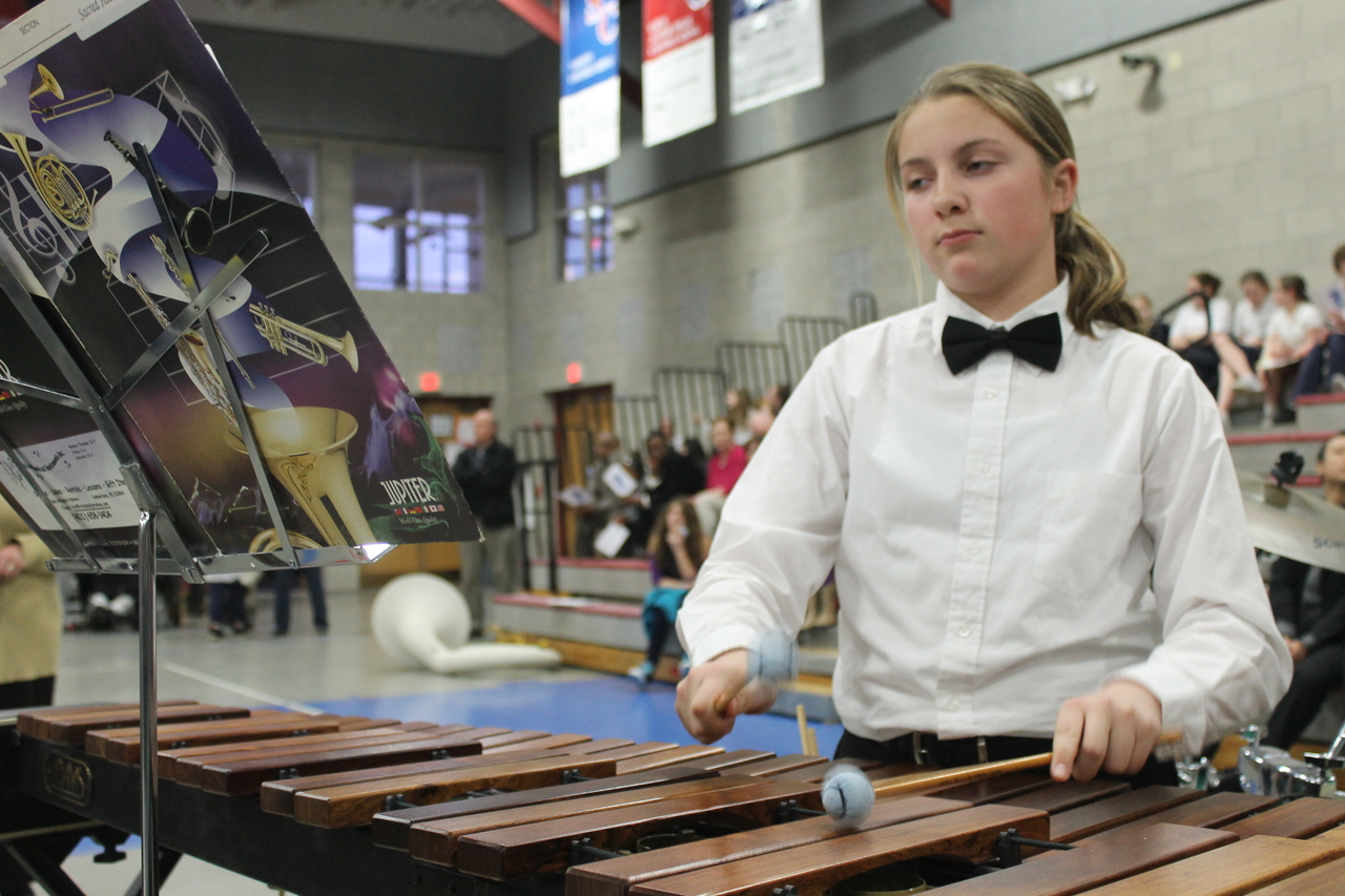 "Saylor Costa, of the Sacred Heart School Band from East Providence, accompanies her fellow musicians on the xylophone in their performance of ""Swahili Folk Hymn"" at the Rhode Island Catholic Elementary/Middle School Band Festival, which was held at Mount St. Charles Academy in Woonsocket."