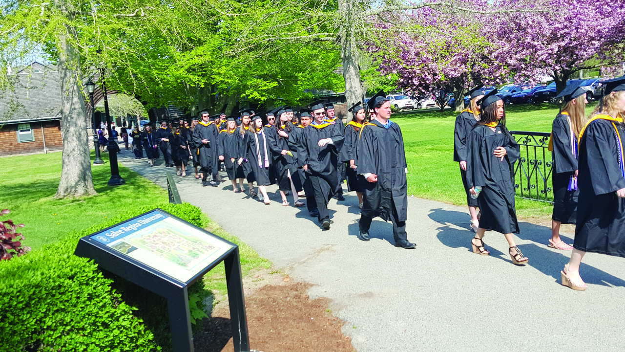 SPRING COMMENCEMENT: Graduates of Salve Regina University proudly process into their commencement ceremony on campus this past Sunday.
