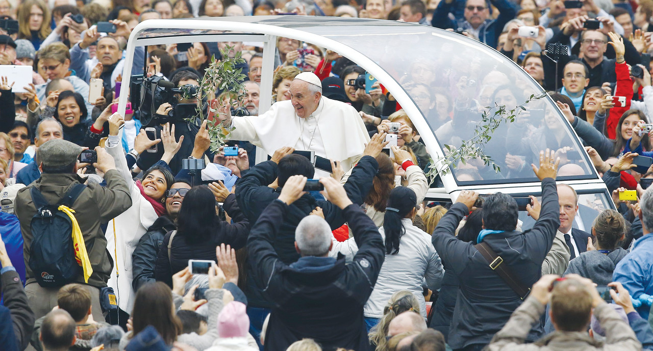 Pope Francis waves as he arrives to lead his weekly audience in St. Peter's Square at the Vatican Oct. 28. (CNS photo/Stefano Rellandini, Reuters) See POPE-AUDIENCE-INTERRELIGIOUS Oct. 28, 2015.